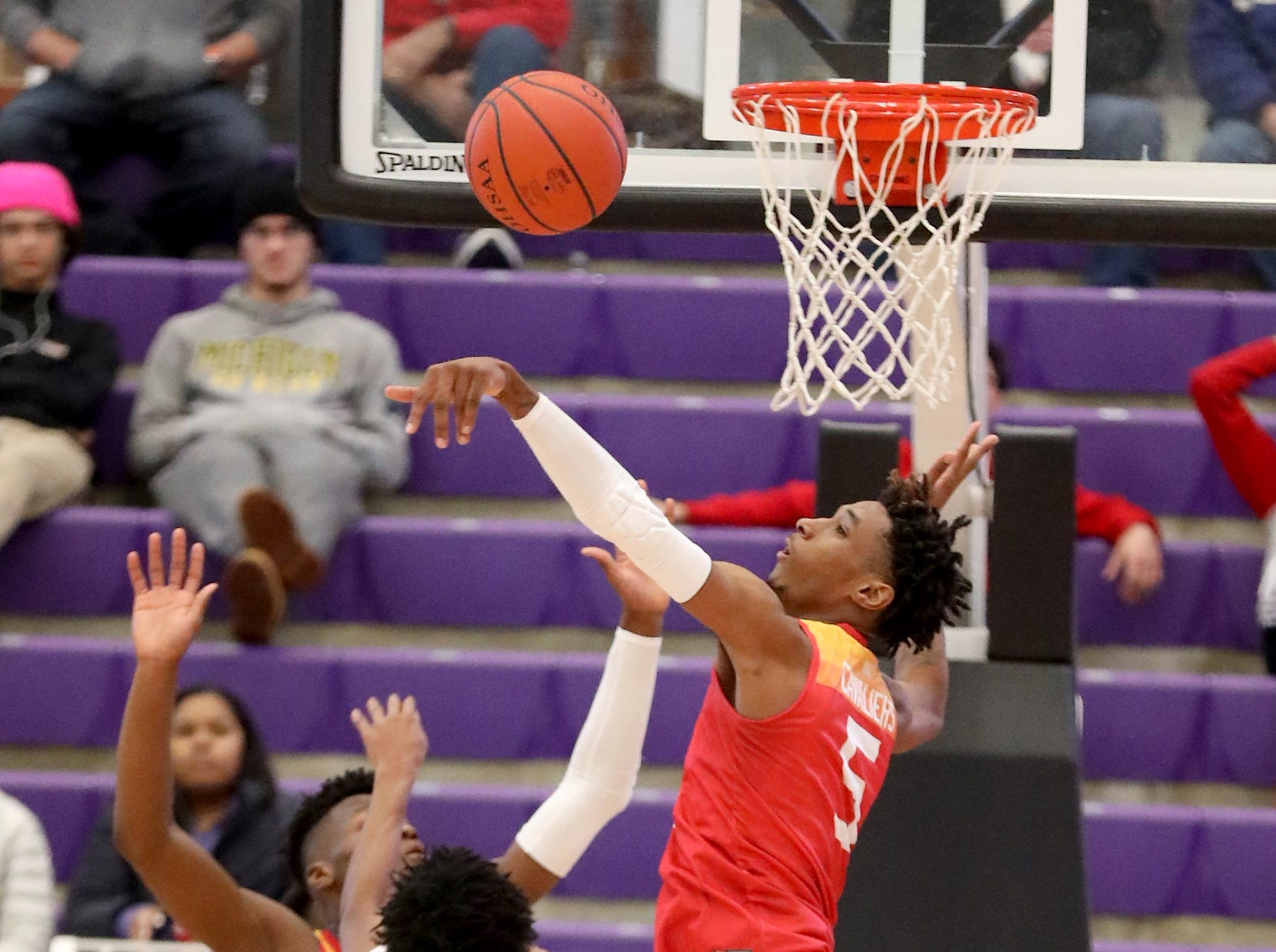 Purcell Marian forward A.J. Garrett blocks a shot by Deer Park guard Steve Gentry during the Midwest King Classic at Wade E Miller Arena Sunday, Jan. 20, 2019.