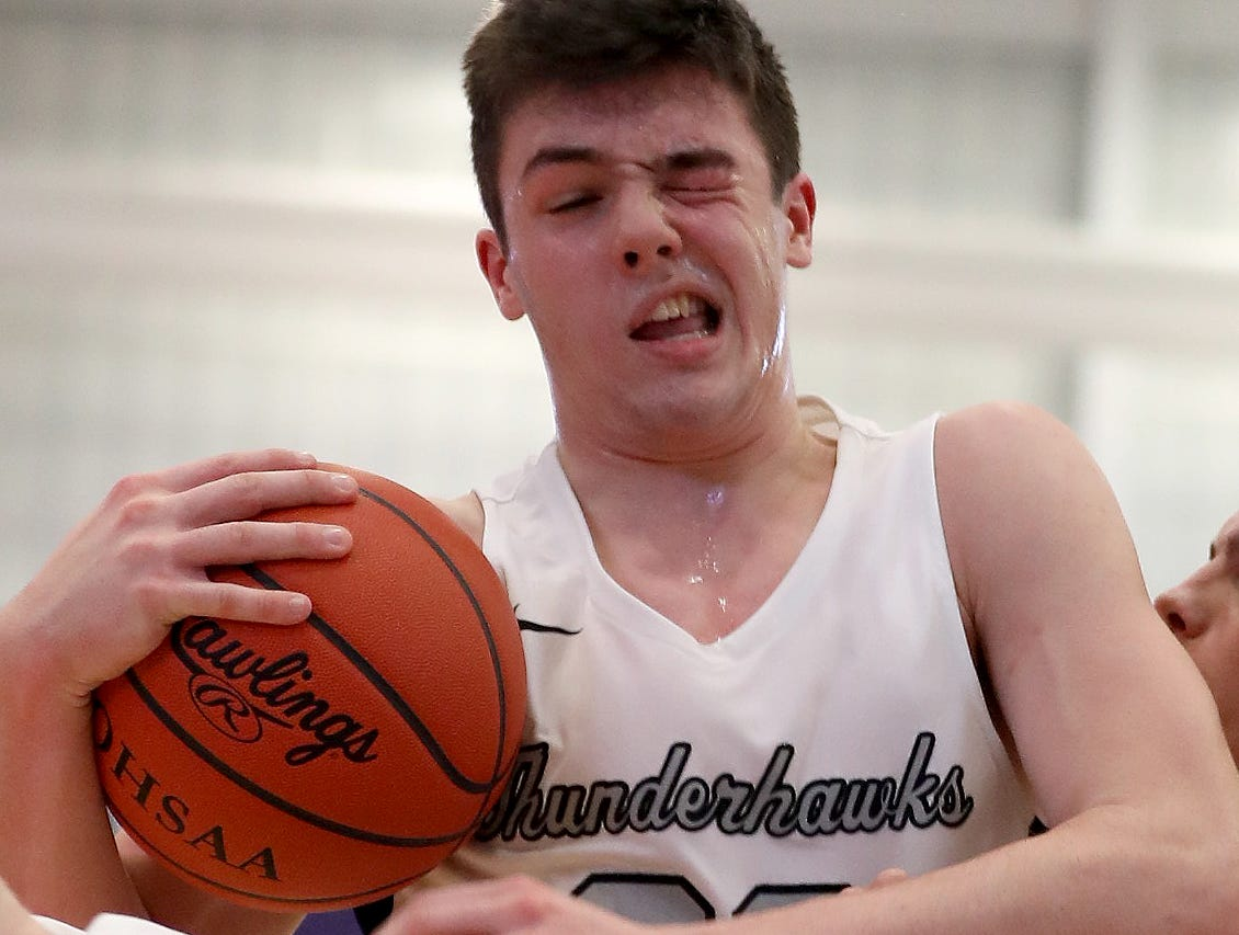 Lakota East guard Bash Wieland gets hit in the eye during the Thunderhawks' basketball game against Moeller in the Midwest King Classic, Sunday, Jan. 20, 2019.