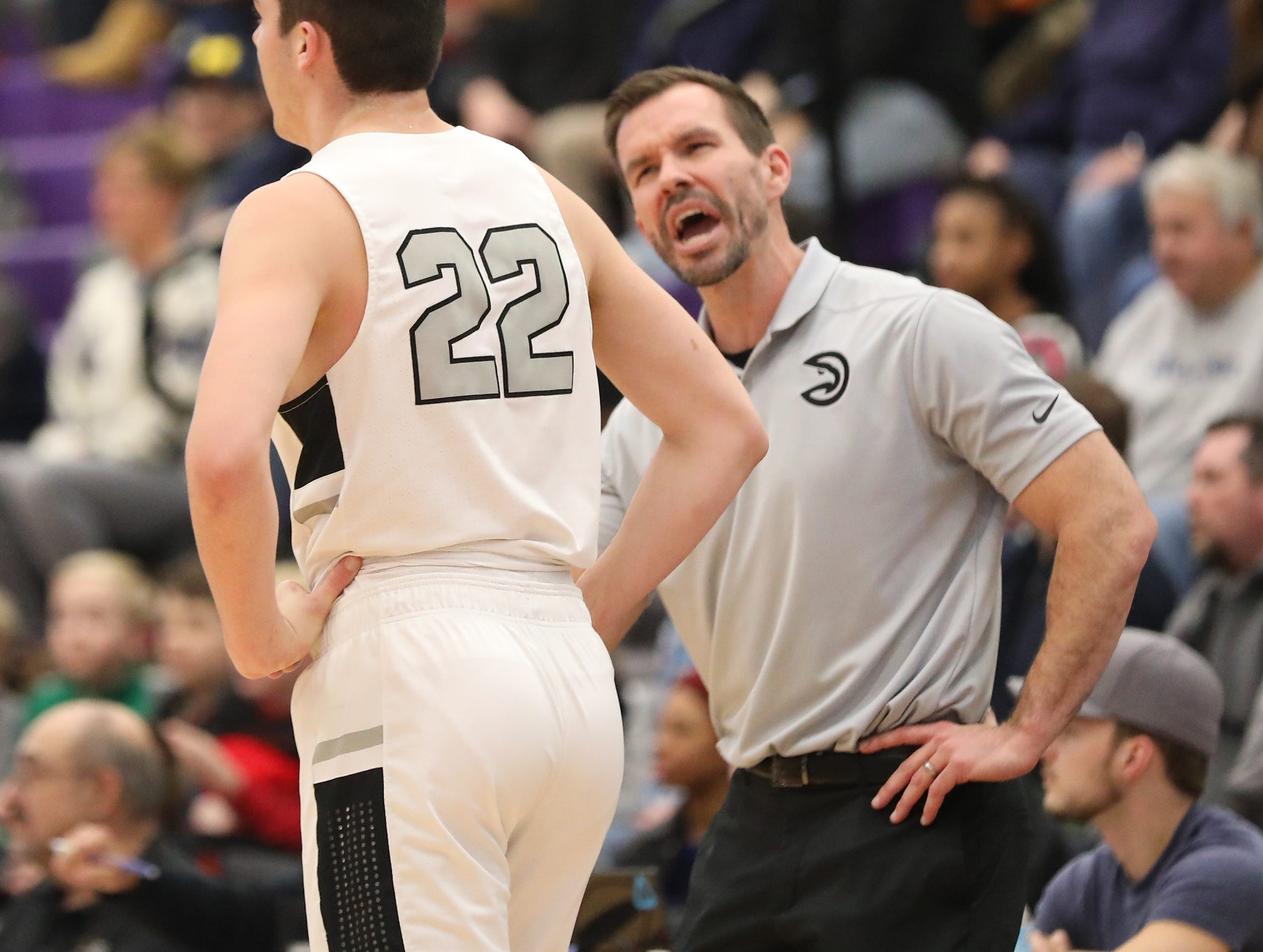 Lakota East coach Clint Adkins talks with Bash Wieland during the Thunderhawks' basketball game against Moeller in the Midwest King Classic at Wade E Miller gymnasium, Sunday, Jan. 20, 2019.