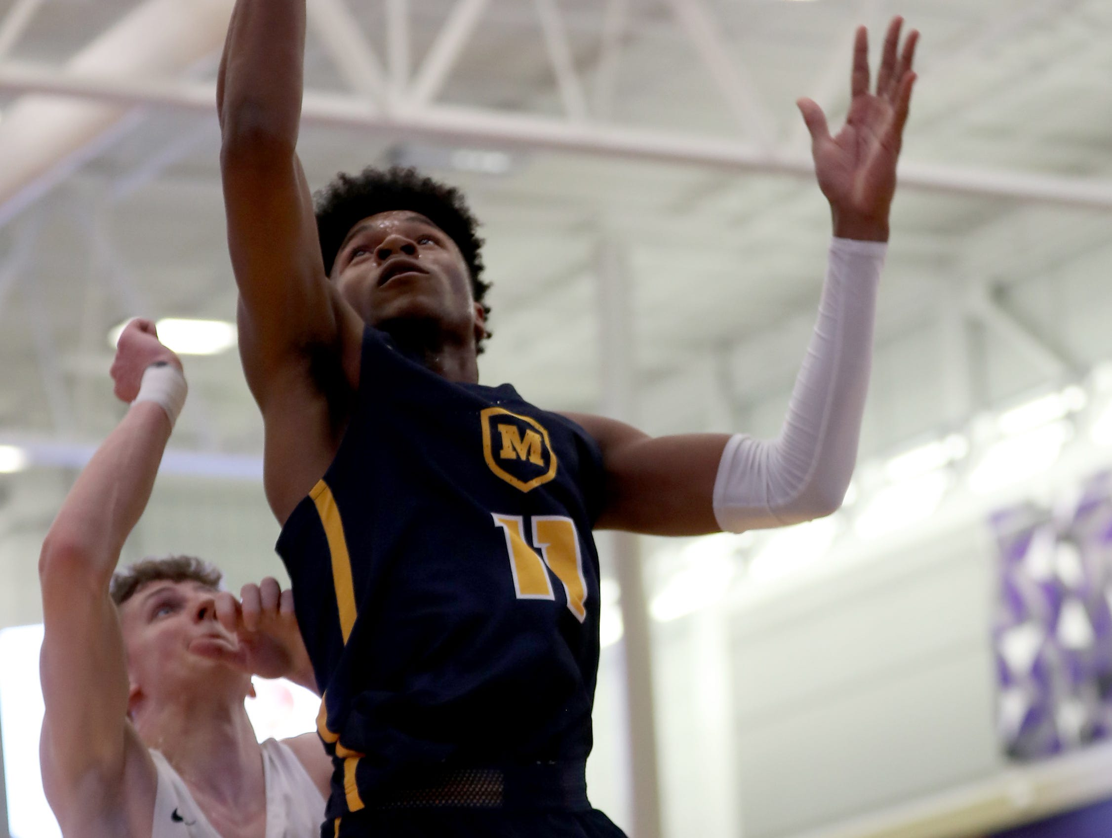 Moeller guard Miles McBride drives to the basket during the Crusaders' win over Lakota East in the Midwest King Classic, Sunday, Jan. 20, 2019.
