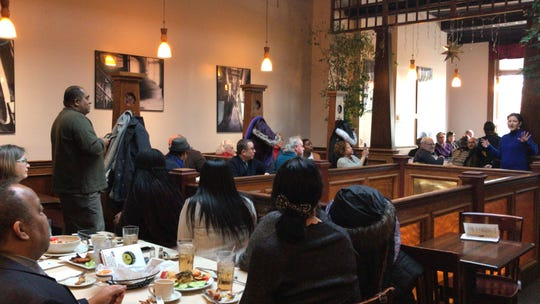 During a kick-off luncheon of the second annual Windows of Understanding social justice-themed public art display, co-founder Cassandra Oliveras Moreno speaks on Martin Luther King Jr. Day at Harvest Moon in New Brunswick. Moreno also is administrator of communications and collaboration in Mason Gross' Department of Art & Design.