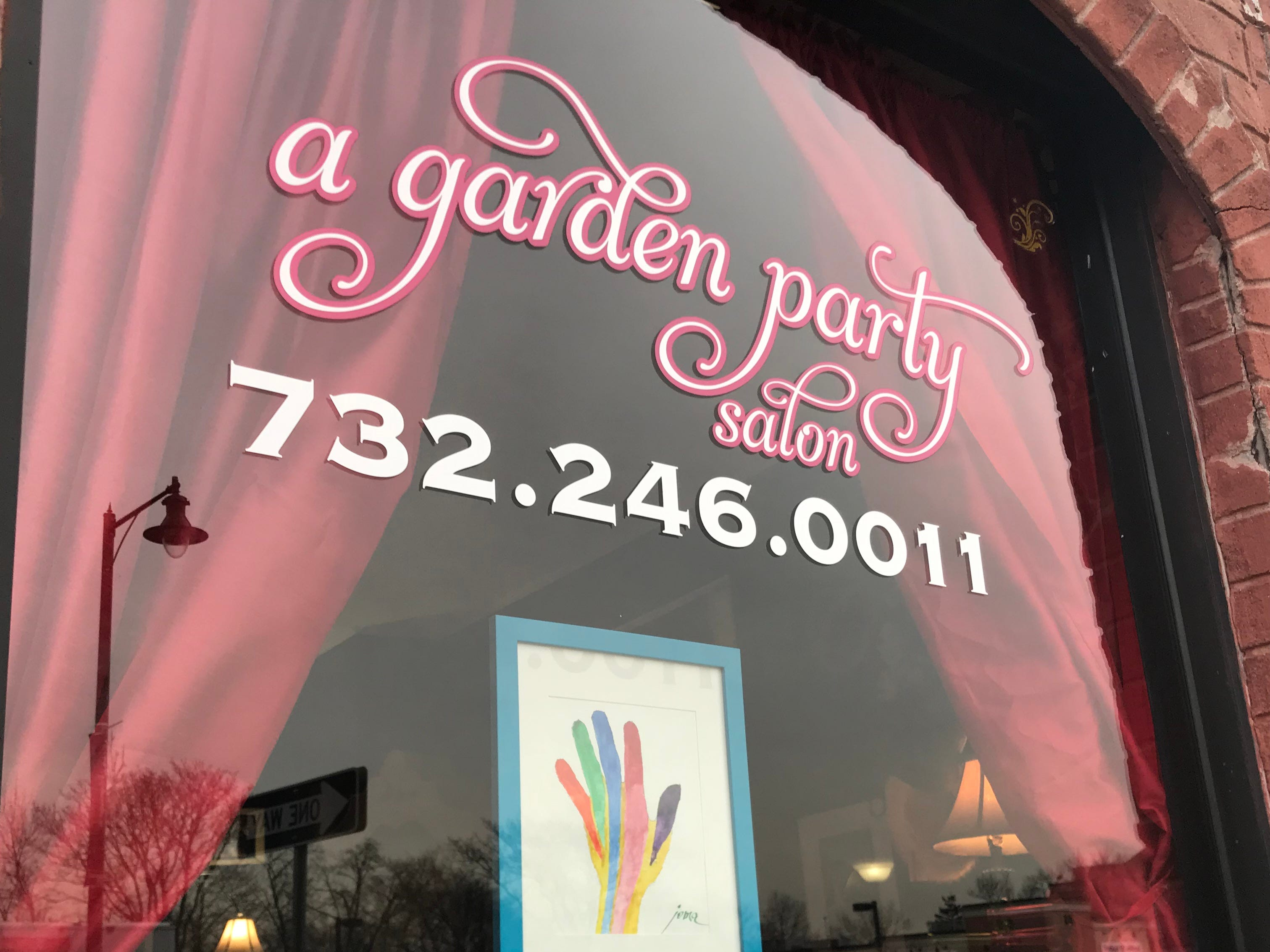 "John Maron's ""Rainbow"" Hand"" aims to raise awareness about the efforts of the Gay Lesbian & Straight Education Network (GLSEN) at A Garden Party Salon in Highland Park as part of the Windows of Understanding social justice display through Feb. 28."