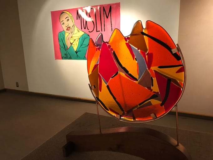 "Ellen Rebarber's ""We Are Many Colors"" fused glass and Muslim Feminists for the Arts' ""Ayana Ife"" print are part of the ""Windows of Understanding"" display at the Museum of the American Hungarian Foundation in New Brunswick through Feb. 28."