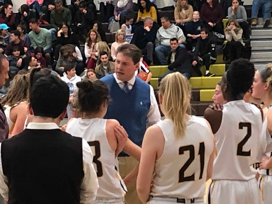 Watchung Hills girls basketball coach Reese Kirchofer huddles up with his team, Jan. 10, 2019