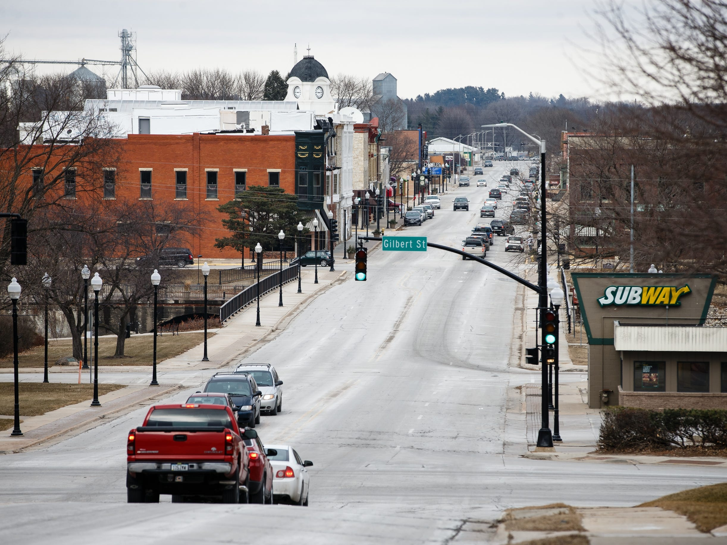 The clock tower of McQuillen Place is seen looking over downtown Charles City on Wednesday, Jan. 16, 2019, in Charles City. Charles Thomson wanted to bring together housing and retail on the city's busiest intersection, but financing troubles and spats with the state have left the project in limbo for the past year.
