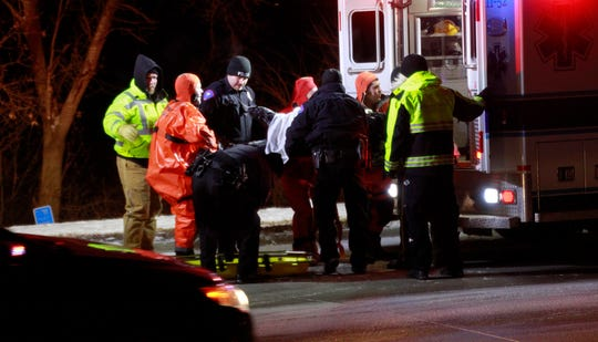 Emergency personnel in action Sunday evening on Storm Lake after a vehicle plunged through the ice. Two people died in the incident, according to the Buena Vista County Sheriff's Office, and two others were airlifted to a South Dakota hospital.
