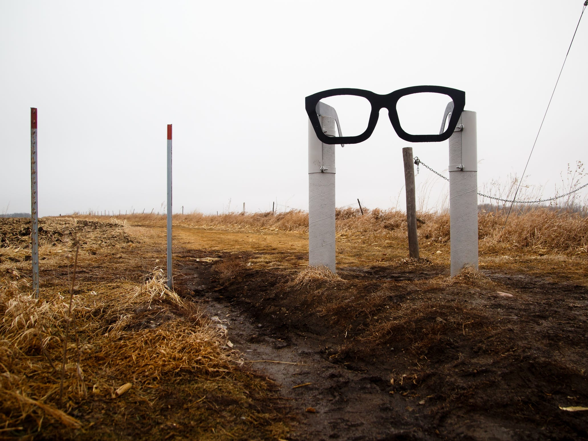 "A pair of glasses marks the spot where a  memorial to Buddy Holly, Ritchie Valens, and J.P. ""the Big Bopper"" Richardson sits in the field on Tuesday, Jan. 15, 2019, in Clear Lake where their plane crashed on February 3, 1959 after their concert at the Surf Ballroom during the Winter Dance Party tour."