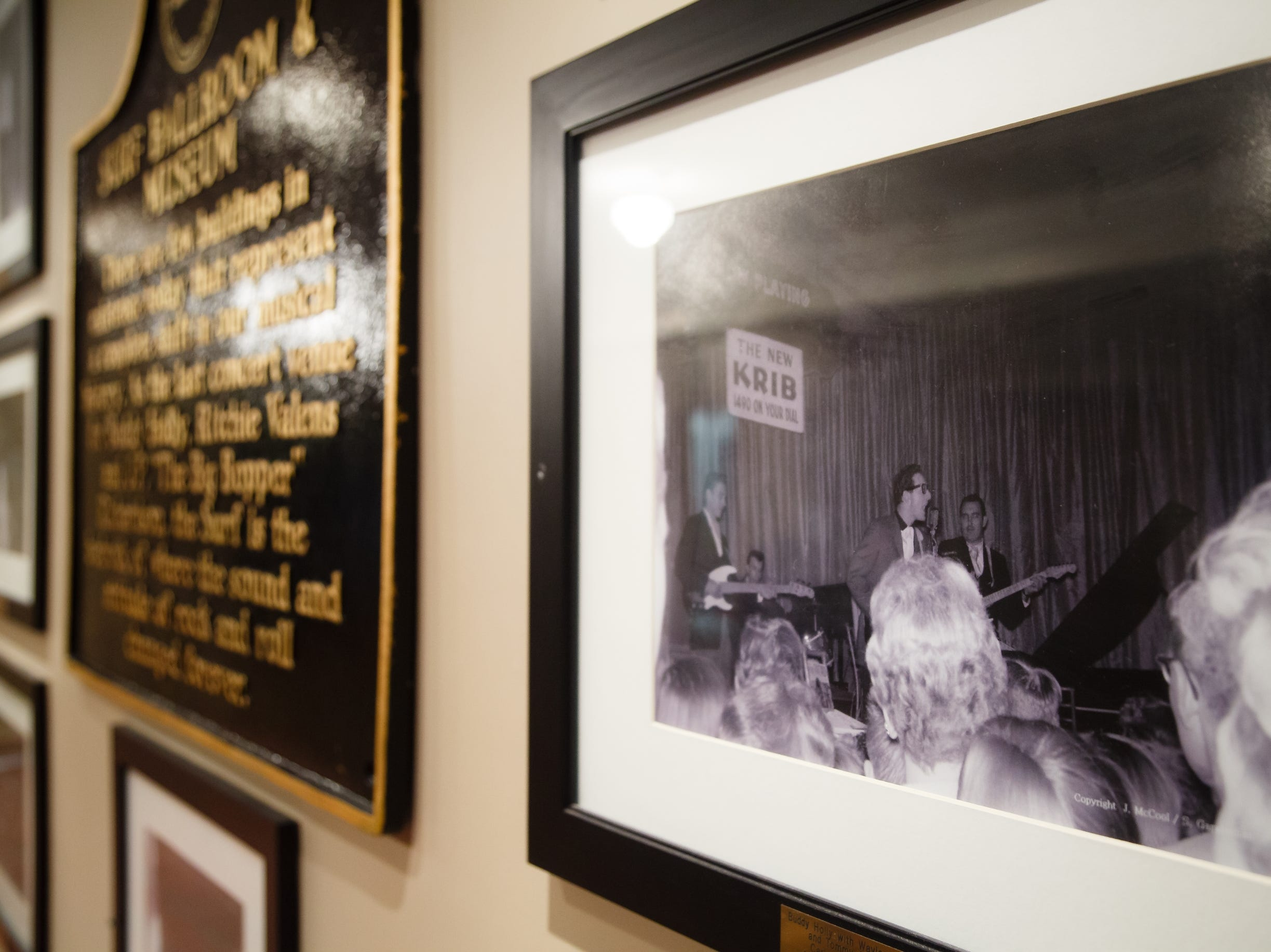 "Photos of Buddy Holly, Ritchie Valens and J.P. ""the Big Bopper"" Richardson taken by spectators in the audience during the Winter Dance Party in 1959 hang in the lobby of the Surf ballroom on Tuesday, Jan. 15, 2019, in Clear Lake."
