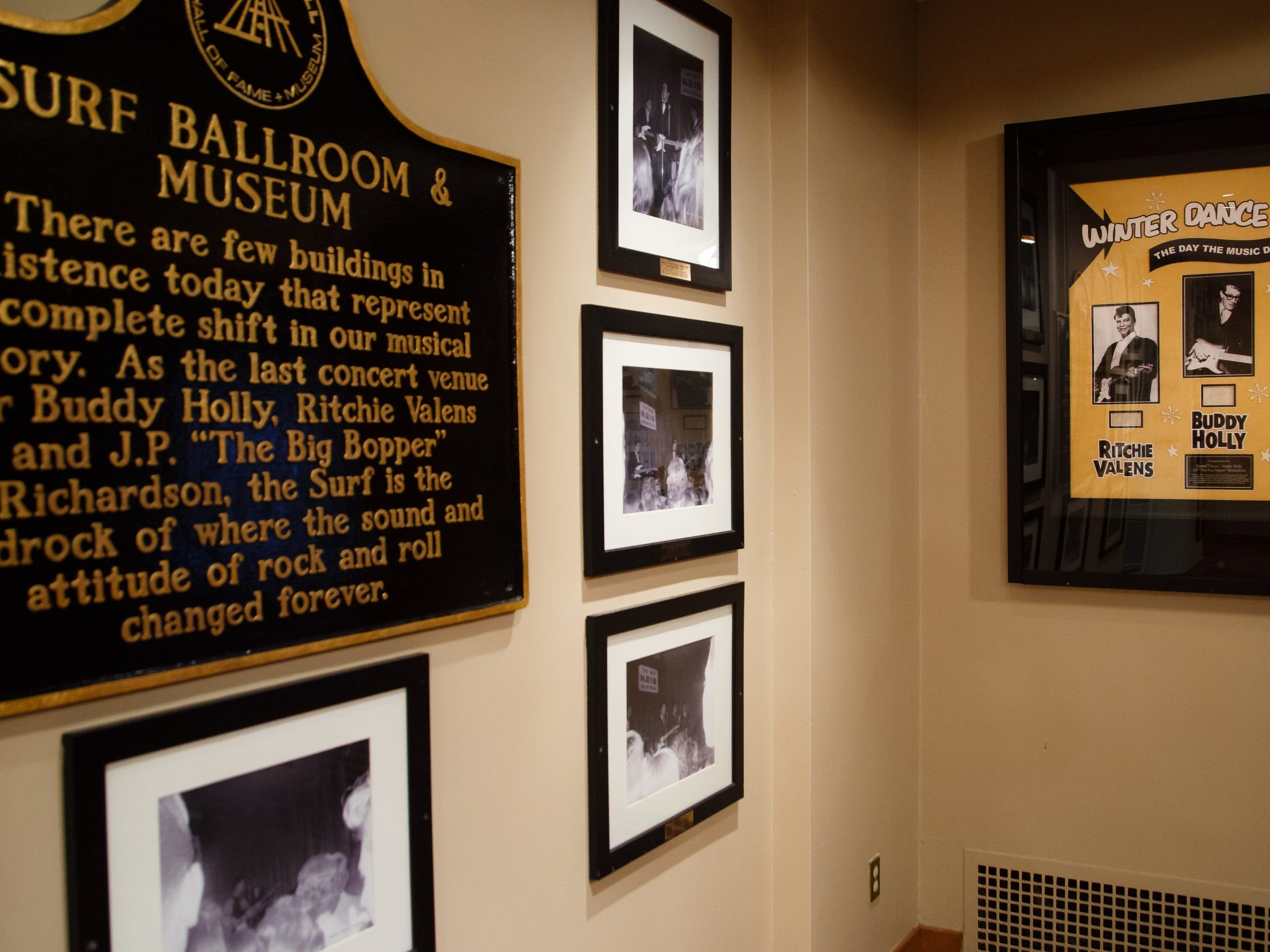 "A plaque from the Rock and Roll Hall of Fame hangs surrounded by photos of Buddy Holly, Ritchie Valens andJ.P. ""the Big Bopper"" Richardson taken by spectators in the audience during the Winter Dance Party in 1959 hang in the lobby of the Surf ballroom on Tuesday, Jan. 15, 2019, in Clear Lake."