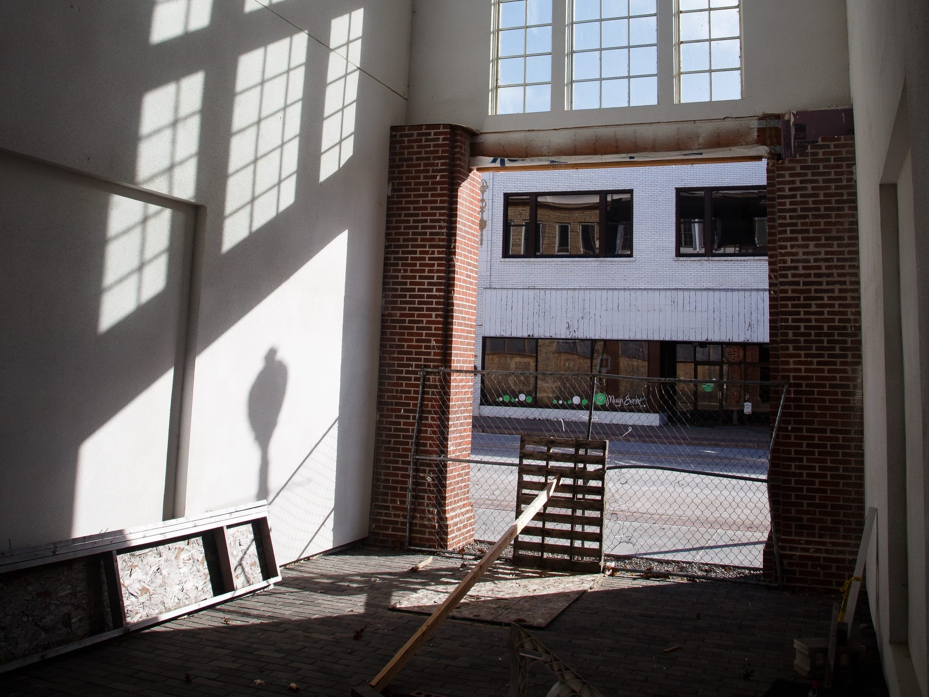 A breezeway through two of the buildings that make up McQuillen Place is seen on Wednesday, Jan. 16, 2019, in Charles City. The project sits on a corner of Charles City's busiest intersection and includes one floor of Main Street retail space with two floors of apartments. Owner Charles Thomson used a multitude of financing deals to fund the project including money from the Iowa Economic Development Authority, whom he claims pulled out after saying he missed an arbitrary deadline. Without the state funding, banks began to pull out of the project which has been sitting vacant and about 90 percent complete for the past year.