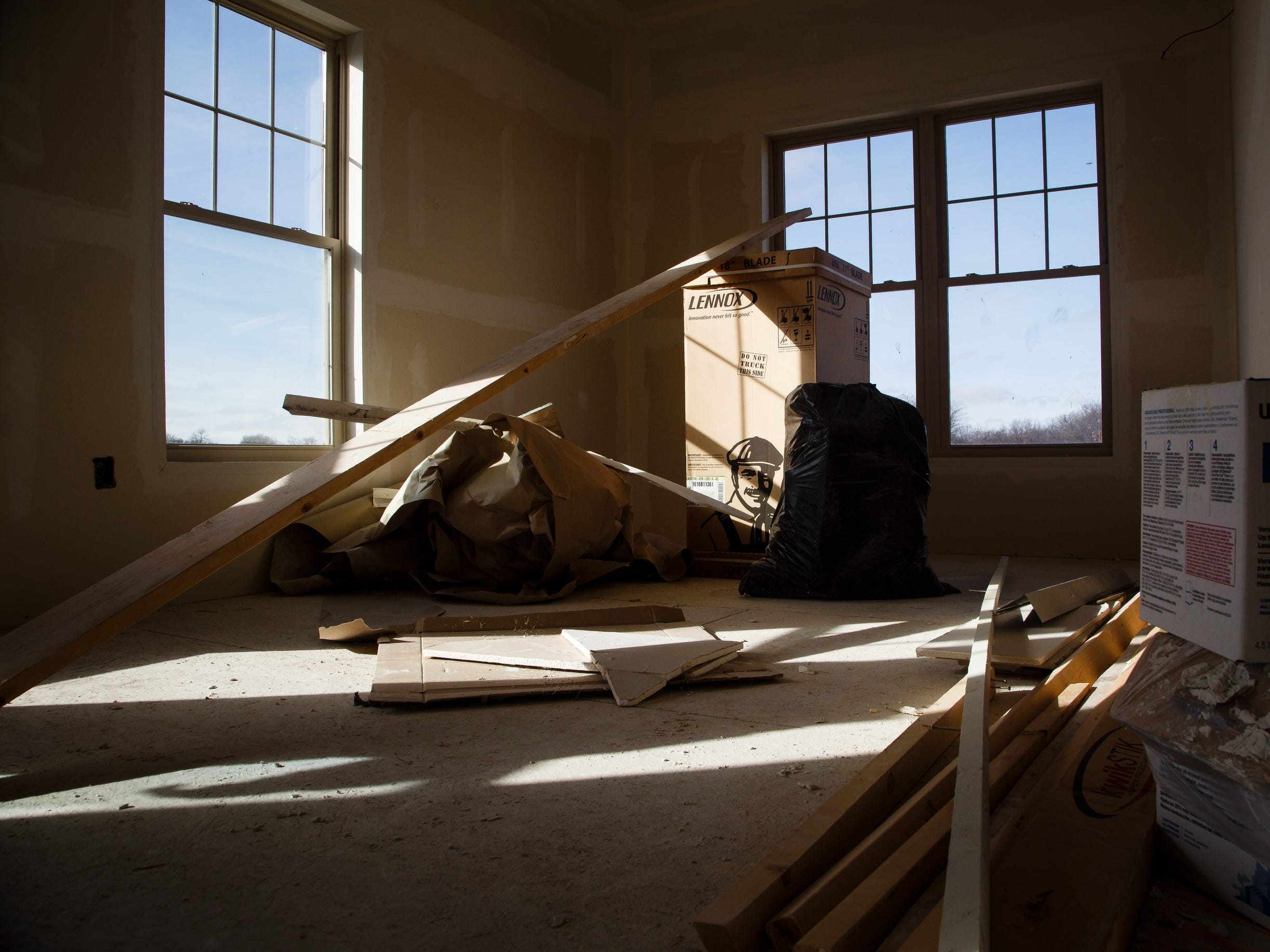 Building materials sit in an unfinished kitchen of an apartment in McQuillen Place on Wednesday, Jan. 16, 2019, in Charles City. The project sits on a corner of Charles City's busiest intersection and includes one floor of Main Street retail space with two floors of apartments. Owner Charles Thomson used a multitude of financing deals to fund the project including money from the Iowa Economic Development Authority, whom he claims pulled out after saying he missed an arbitrary deadline. Without the state funding, banks began to pull out of the project which has been sitting vacant and about 90 percent  complete for the past year.