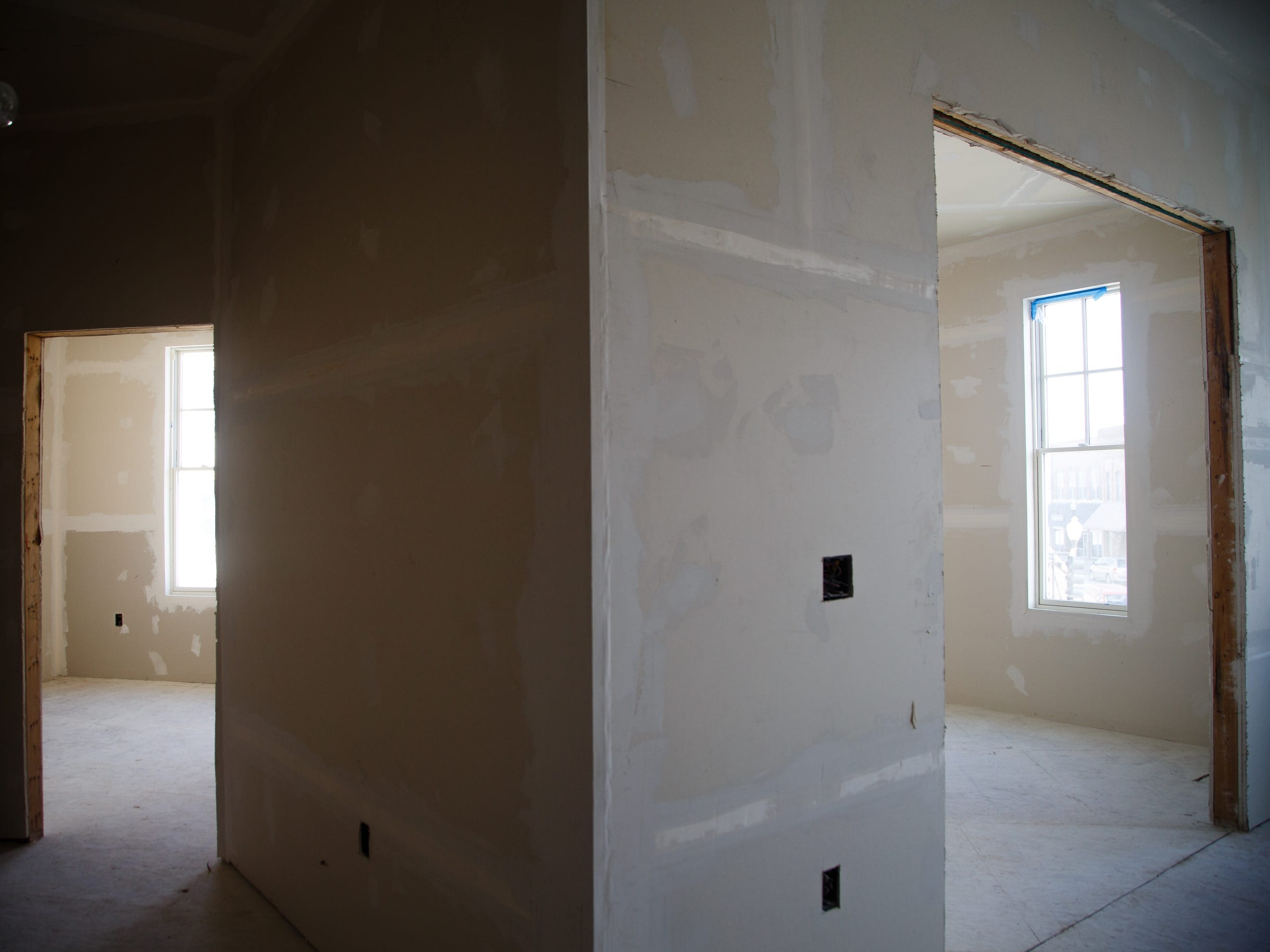 An unfinished apartment in McQuillen Place is seen on Wednesday, Jan. 16, 2019, in Charles City. The project sits on a corner of Charles City's busiest intersection and includes one floor of Main Street retail space with two floors of apartments. Owner Charles Thomson used a multitude of financing deals to fund the project including money from the Iowa Economic Development Authority, whom he claims pulled out after saying he missed an arbitrary deadline. Without the state funding, banks began to pull out of the project which has been sitting vacant and about 90 percent complete for the past year.