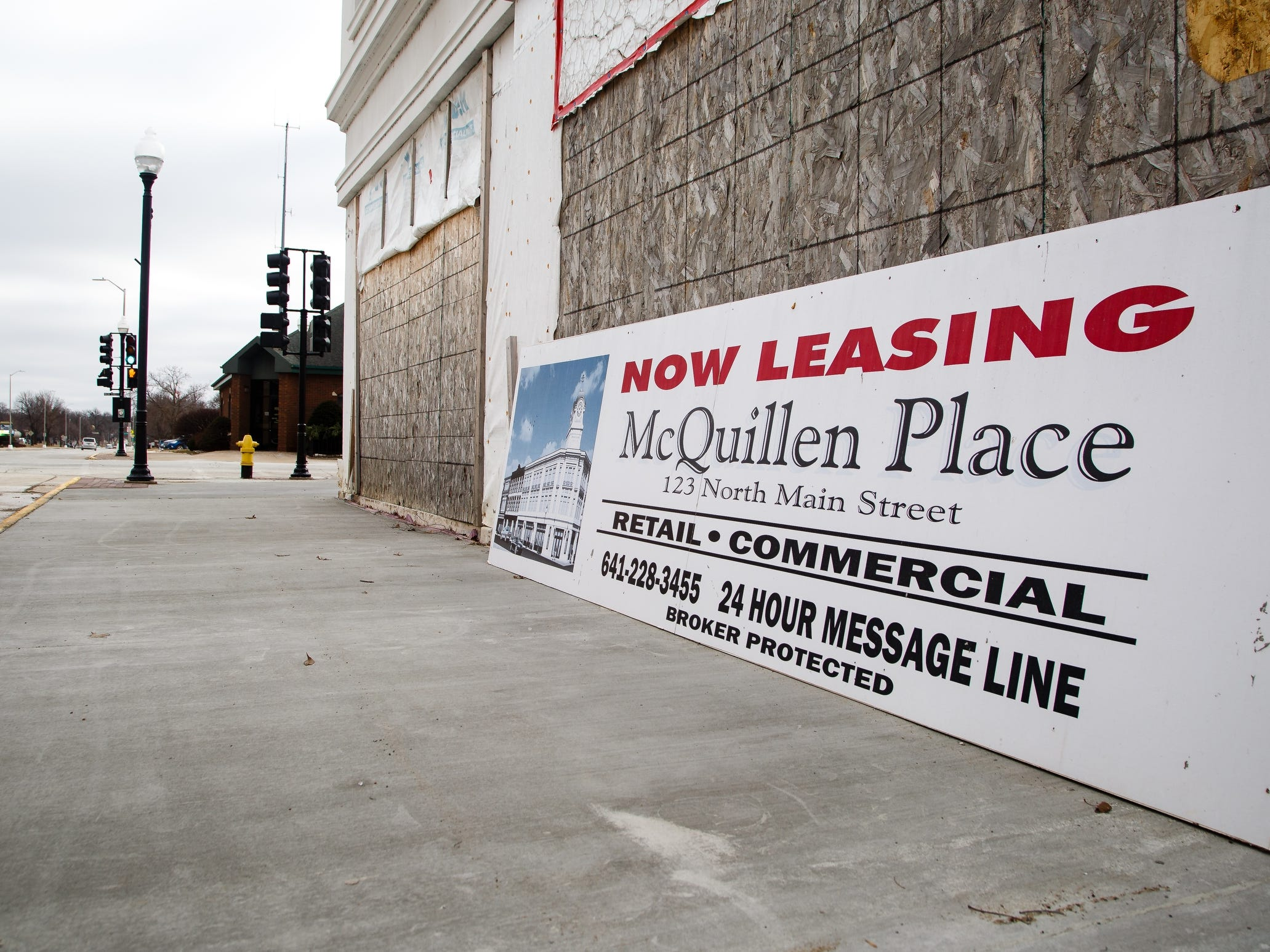 Charles Thomson tried to bring much-needed housing to downtown Charles City. His McQuillen Place sits at the town's busiest intersection and was built over an empty lot. The project includes one floor of Main Street retail space and two floors of apartments, sits nearly completed, but Thomson fears it may never be completed. His complex financing package included about $700,000 in tax credits from the Iowa Economic Development Authority.  That's only a small share of the $10 million project, but the state's backing was crucial in receiving bank financing. Thomson claims the state suddenly reneged on its offer and told him he missed an arbitrary deadline to cash in the credits. With that funding gone, the bank called its loan and began foreclosure on the building.