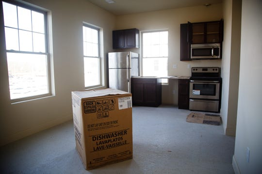 Appliances sit in an unfinished kitchen of an apartment in McQuillen Place on Wednesday, Jan. 16, 2019, in Charles City. The project sits on a corner of Charles City's busiest intersection and includes one floor of Main Street retail space with two floors of apartments. Owner Charles Thomson used a multitude of financing deals to fund the project including money from the Iowa Economic Development Authority, whom he claims pulled out after saying he missed an arbitrary deadline. Without the state funding, banks began to pull out of the project which has been sitting vacant and about 90 percent complete for the past year.