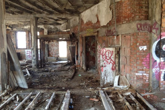 The interior of the Metropolitan Building on Sept. 5, 2014 was completely trashed.