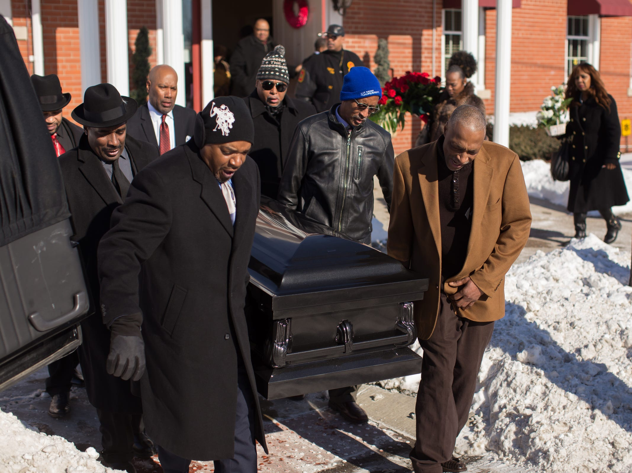 The casket of the late Rudy Barker is carried towards the hearse following his funeral service at Hutchison Funeral Home in Detroit on Monday, January 21, 2019. Barker was known for his impressions of late civil rights leader Martin Luther King Jr. and was buried on the national holiday honoring his hero.