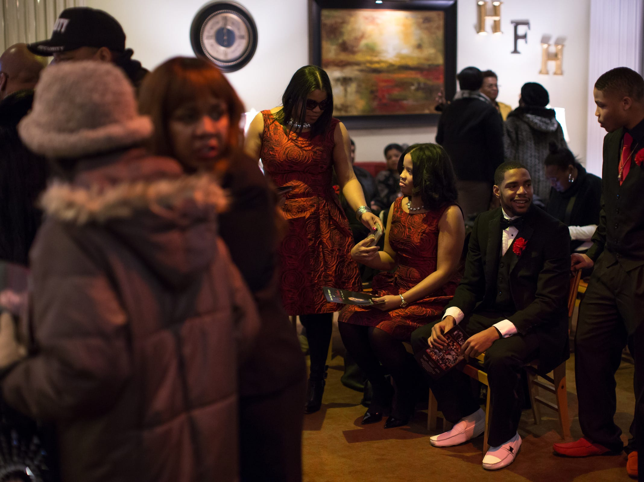 (right to left) Branderian Barker, BreÕAndre Barker, Britney Sharp and Misty Sharp, all of Detroit, sit as guests arrive for the funeral of their father, the late Rudy Barker, at Hutchison Funeral Home in Detroit on Monday, January 21, 2019. Barker was known for his impressions of late civil rights leader Martin Luther King Jr. and was buried on the national holiday honoring his hero.