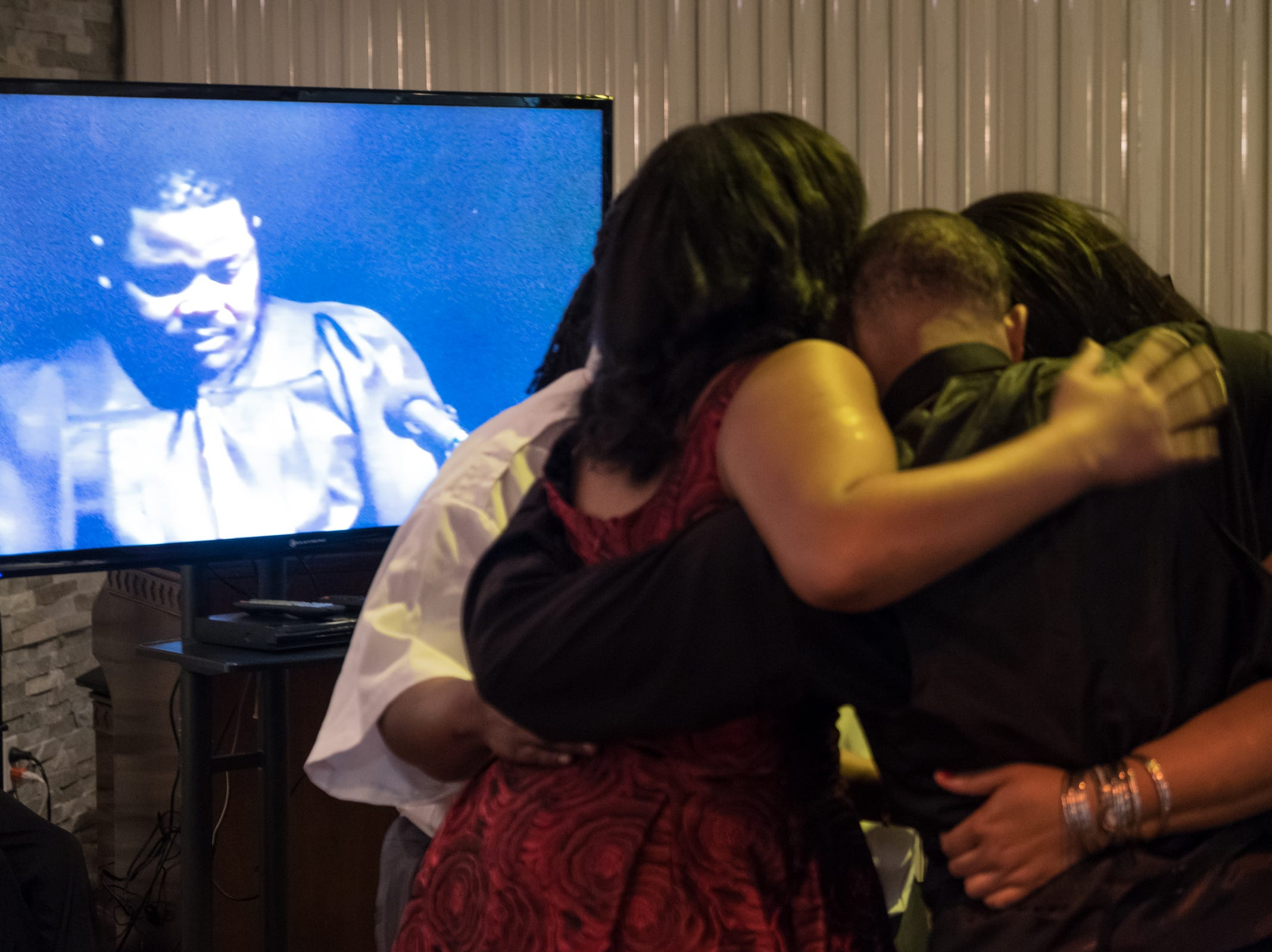 Children of the late Rudy Barker embrace as a video of their father is seen at the end of his funeral at Hutchison Funeral Home in Detroit on Monday, January 21, 2019. Barker was known for his impressions of late civil rights leader Martin Luther King Jr. and was buried on the national holiday honoring his hero.