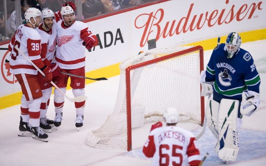 Red Wings left wing Thomas Vanek celebrates his goal past Canucks goaltender Jacob Markstrom with teammates during the second period of the Wings' 3-2 loss on Sunday, Jan. 20, 2019, in Vancouver, British Columbia.