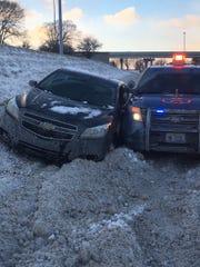 A Michigan State Police SUV was hit by a 2013 Chevy Malibu on southbound I-75 near the Davison Freeway on Jan. 20, 2019.