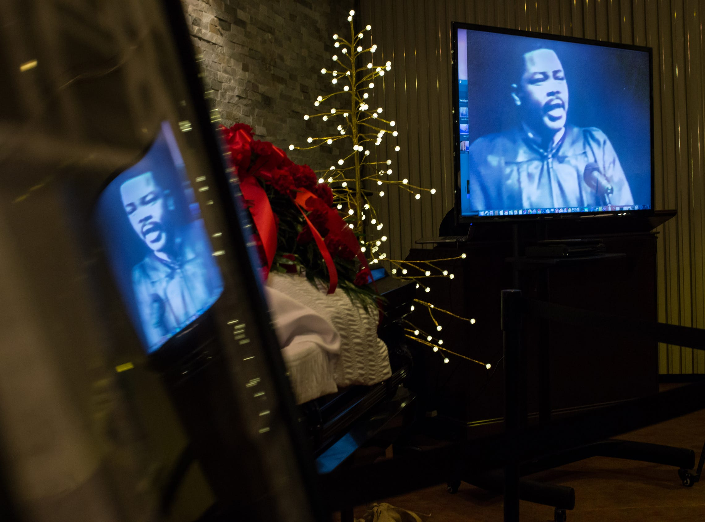 A video of the late Rudy Barker impersonating late civil rights leader Martin Luther King Jr. plays next to his casket during his funeral at Hutchison Funeral Home in Detroit on Monday, January 21, 2019. Barker was known for his impressions of late civil rights leader Martin Luther King Jr. and was buried on the national holiday honoring his hero.