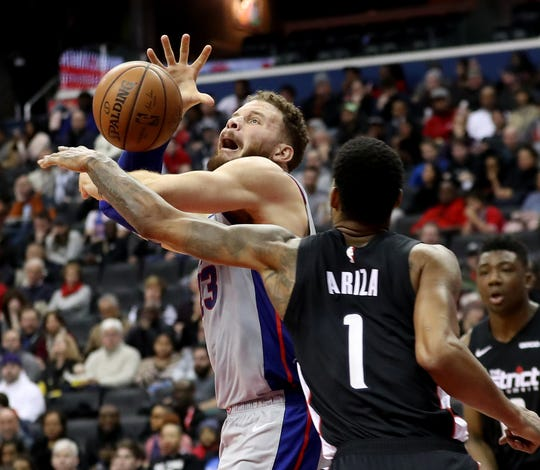 Pistons forward Blake Griffin is fouled by Wizards forward Trevor Ariza during the first half on Monday, Jan. 21, 2019, in Washington.