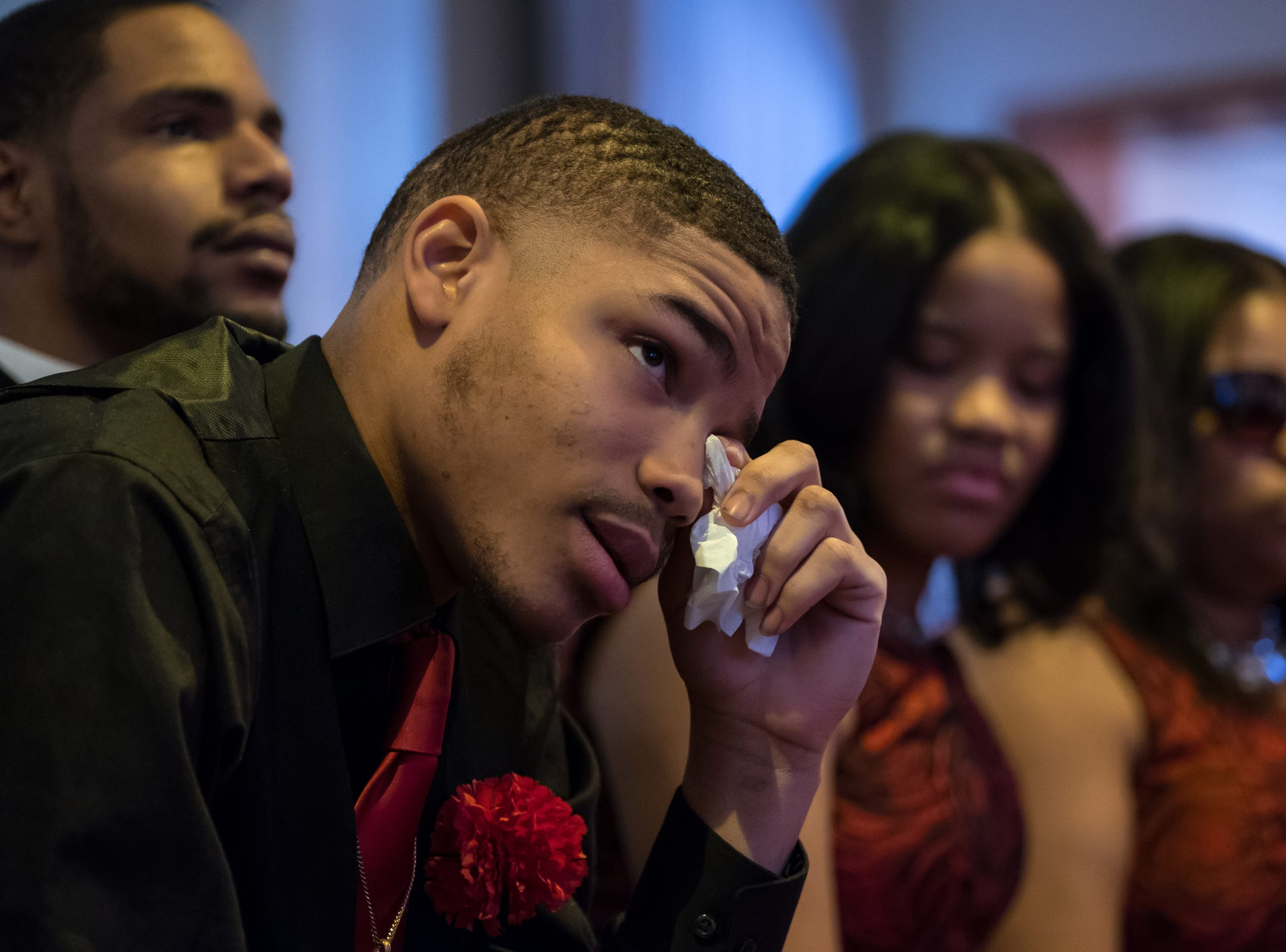 Branderian Barker of Detroit sheds a tear for his father the late Rudy Barker during his funeral at Hutchison Funeral Home in Detroit on Monday, January 21, 2019. Barker was known for his impressions of late civil rights leader Martin Luther King Jr. and was buried on the national holiday honoring his hero.