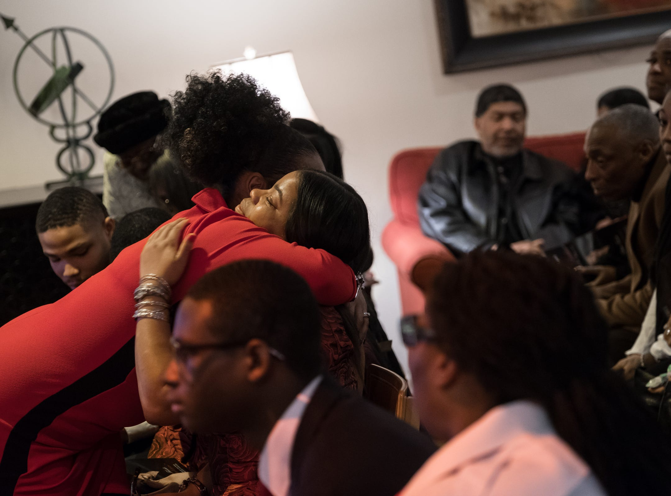 Misty Sharp of Detroit is hugged during the funeral of her father Rudy Barker at Hutchison Funeral Home in Detroit on Monday, January 21, 2019. Barker was known for his impressions of late civil rights leader Martin Luther King Jr. and was buried on the national holiday honoring his hero.