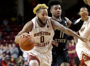 Boston College's Ky Bowman (0) drives toward the basket past Florida State's David Nichols (11) in the second half Sunday. Boston College won 87-82.