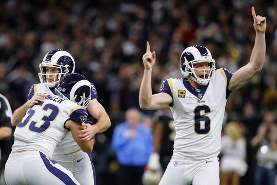 Johnny Hekker (6) and Greg Zuerlein (4) of the Los Angeles Rams celebrate after kicking the winning field goal in overtime against the New Orleans Saints in the NFC championship game Sunday. The Rams defeated the Saints 26-23.