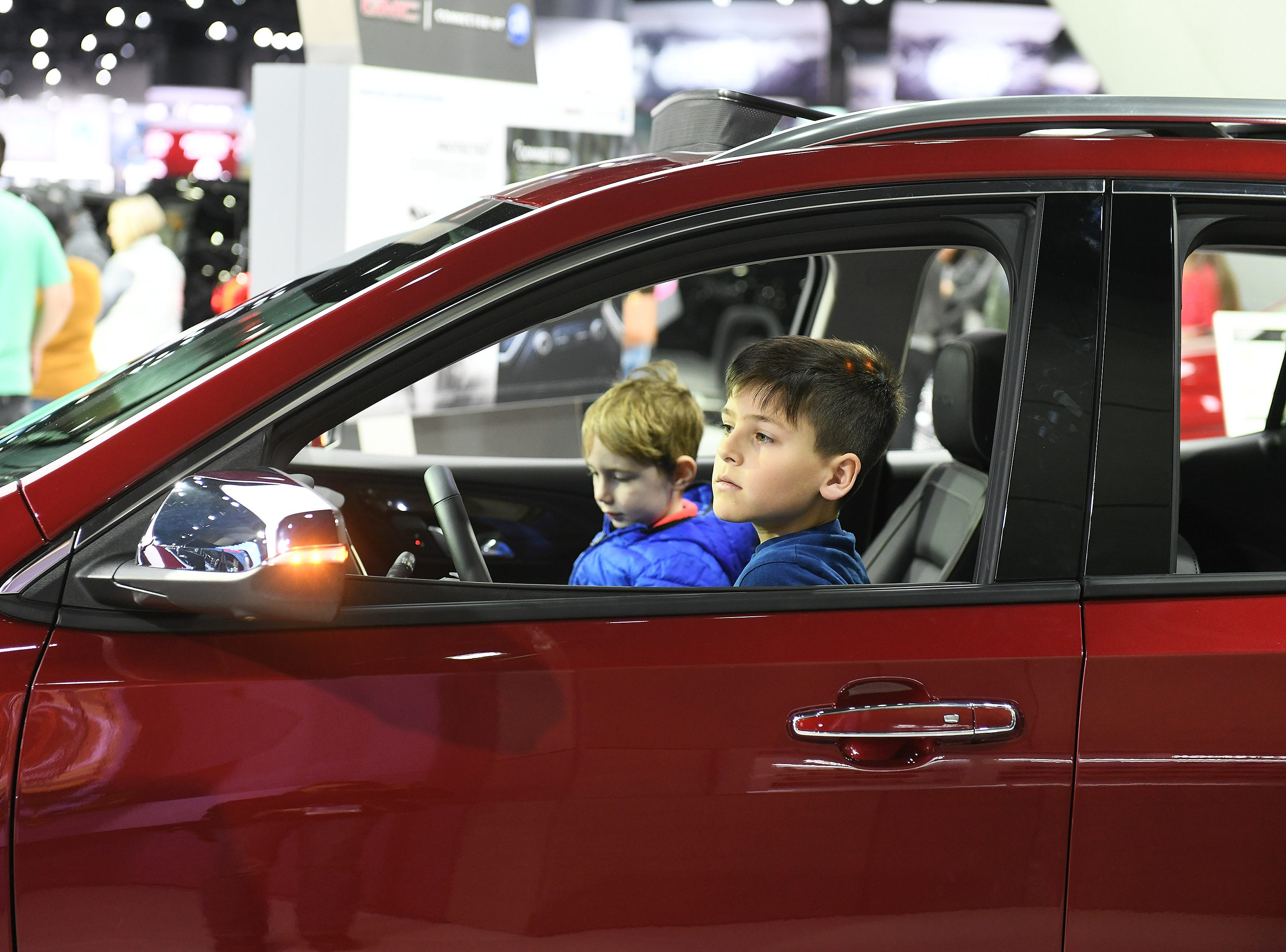 David Baragan, 9, of Washington, right, checks out a 2019 GMC Terrain Denali with Duncan Stranz, 5, of Beverly Hills.