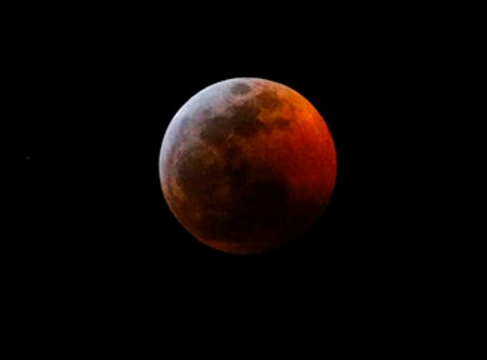 This photo shows the moon during a total lunar eclipse, seen from Los Angeles, Sunday Jan. 20, 2019. The entire eclipse will exceed three hours. Totality - when the moon's completely bathed in Earth's shadow - will last an hour. Expect the eclipsed, or blood moon, to turn red from sunlight scattering off Earth's atmosphere.