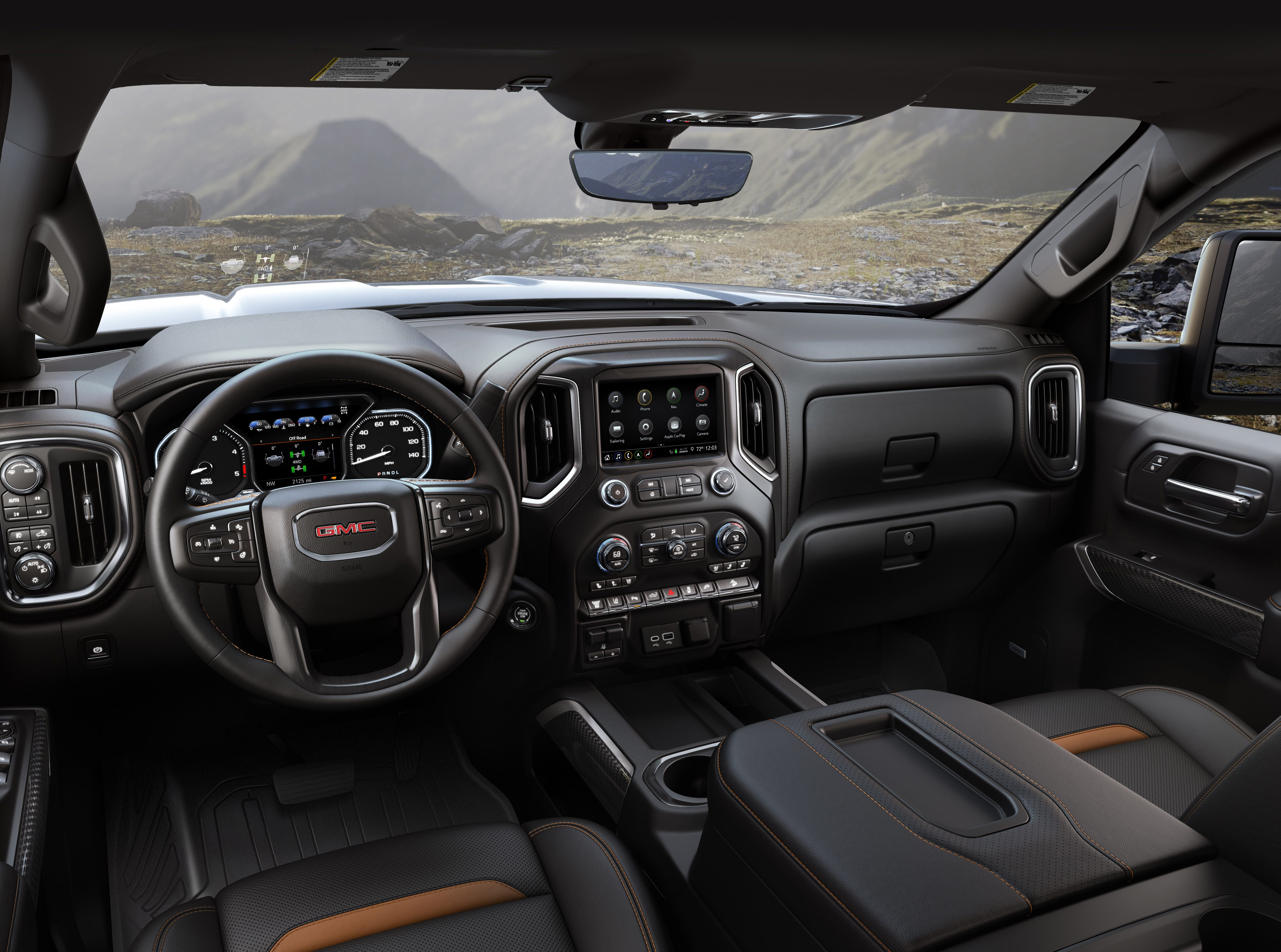 Inside, the Sierra HD's new interior has best-in-class front head- and legroom (maximum), with Crew Cab models. A higher seating position complements the truck's taller profile to offer a confident view from behind the wheel. 2020 GMC Sierra HD AT4 Interior