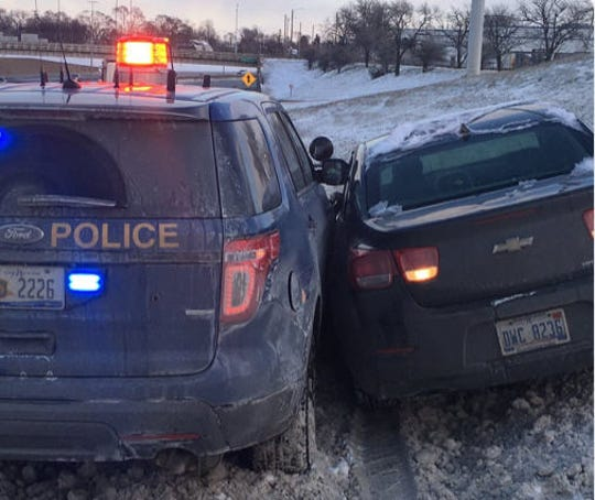 Police said the trooper was stopped on the right shoulder with all his emergency lights on. when a 2013 Chevy Malibu lost control and spun. The Malibu left the roadway and went up the embankment sideswiping the right side of the patrol car.