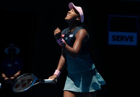 Japan's Naomi Osaka celebrates after defeating Latvia's Anastasija Sevastova during their fourth round match Monday at the Australian Open tennis championships in Melbourne, Australia.