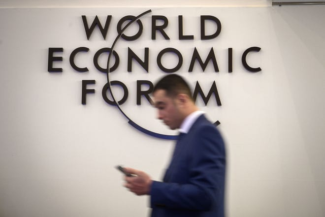 A man walks past a sign of the World Economic Forum (WEF) ahead of the WEF annual meeting at the Congress Centre on January 21, 2019 in Davos, eastern Switzerland.
