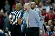 John Beilein of the Michigan Wolverines argues a call with referee Lewis Garrison in the second half against the Wisconsin Badgers.