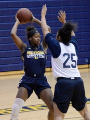 Cydney Williams, left, is Michigan-Dearborn's leading rebounder in her first season after arriving from Wayne State.