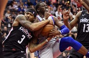 Wizards guard Bradley Beal (3) battles for the ball against Pistons guard Reggie Jackson during the first half.