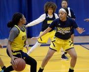 Ro'Zhane Wells, right, defends Chloe Godbold during the Michigan-Dearborn women's basketball team's practice last week. Wells is in his first season at UM-Dearborn after coming over from Saginaw Valley State.