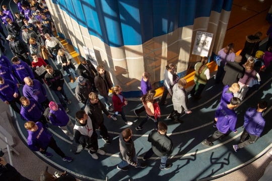 The Symbolic March, commemorating the March on Washington, moves along the track of the University of Evansville's Student Fitness Center Monday afternoon. Icy sidewalks and roads necessitated moving the annual celebration of civil rights leaders, including Dr. Martin Luther King Jr., inside.