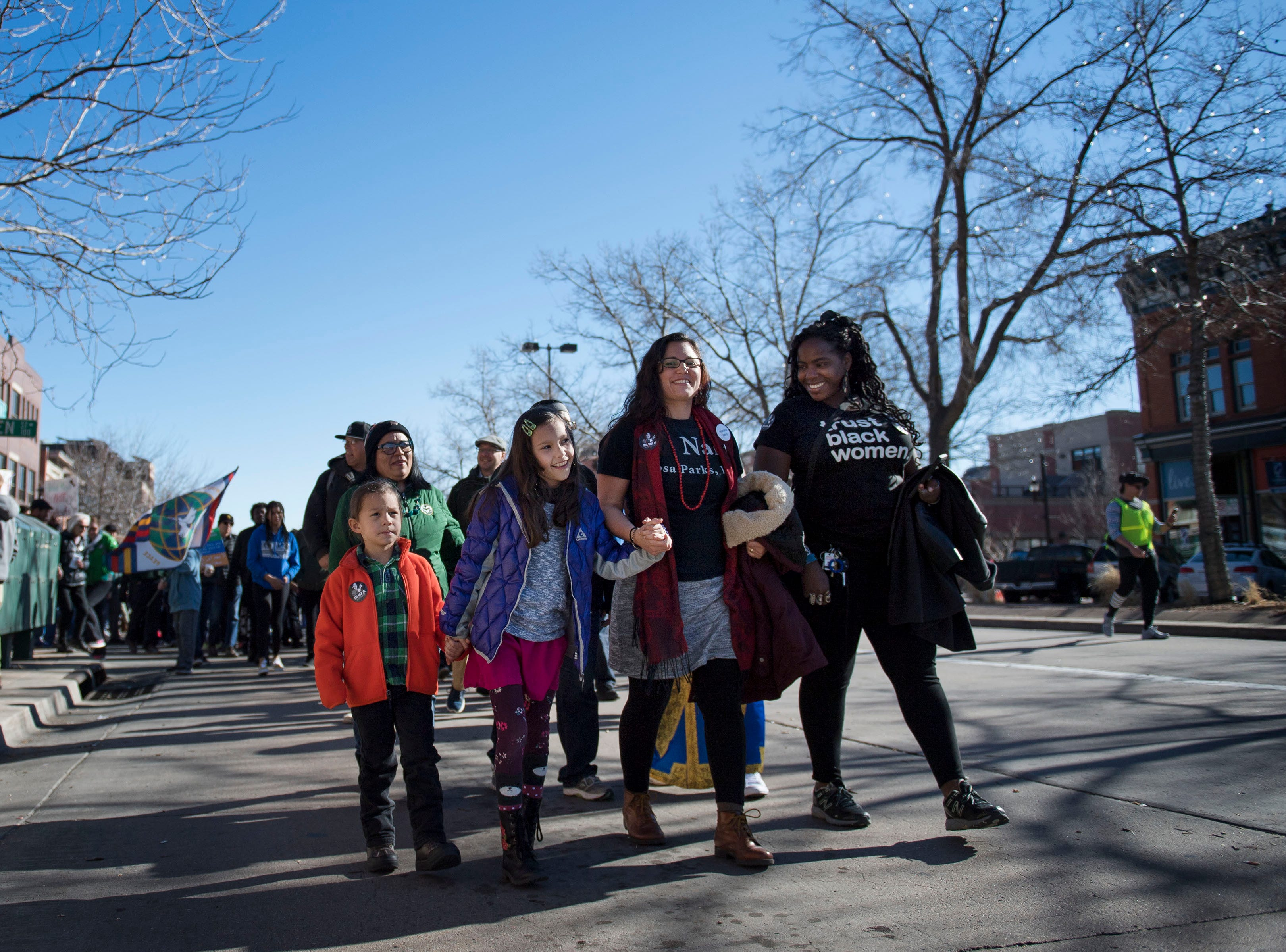 March leader Dominique David-Chavez, third from left, leads the march with her son Miguel, 4, daughter Lillie, 9, and Dr. Melissa Edwards during the Dr. Martin Luther King, Jr. March & Celebration on Monday, Jan. 21, 2019, in Fort Collins, Colo.