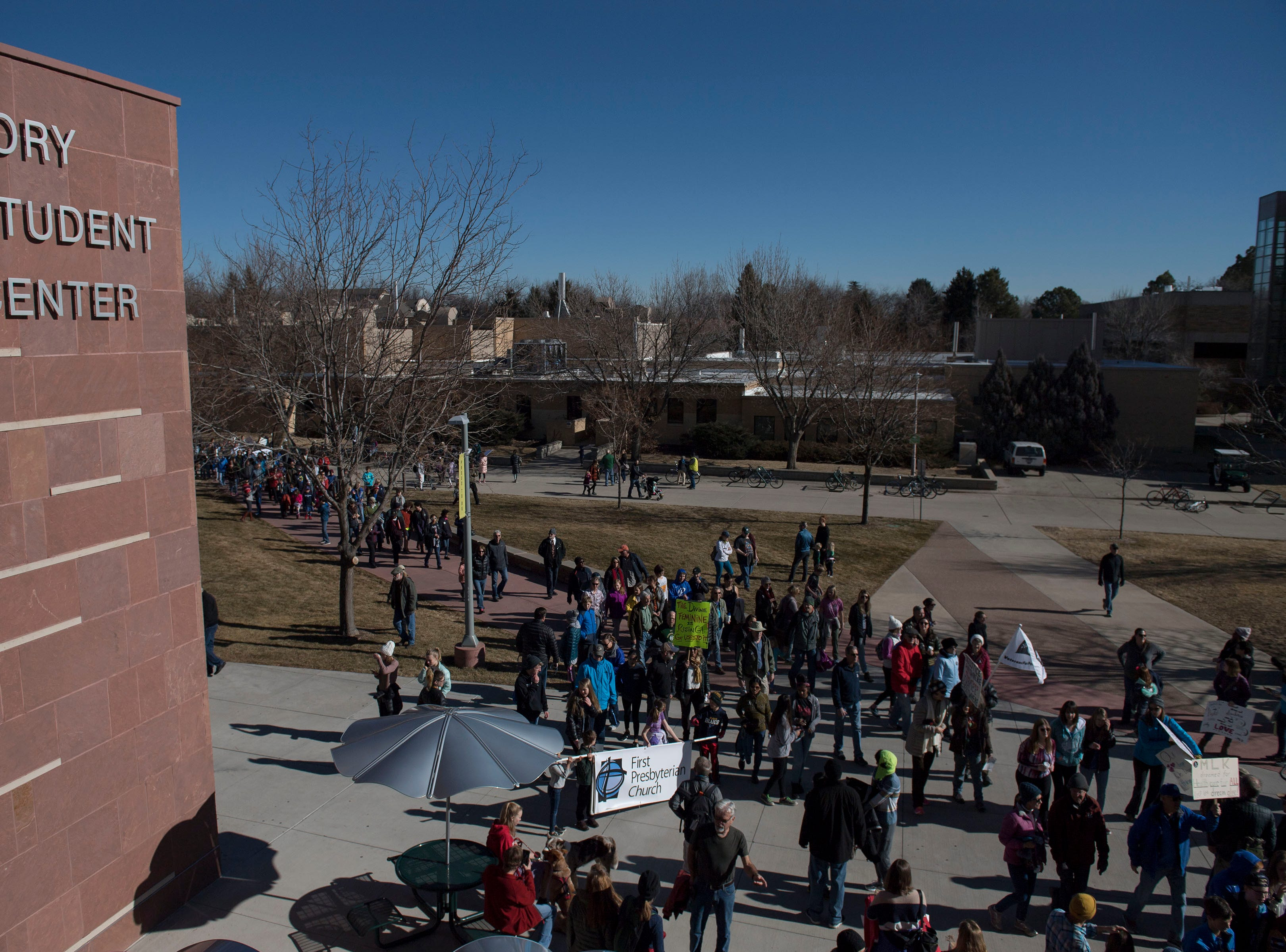March participants walk into the Lory Student Center during the Dr. Martin Luther King, Jr. March & Celebration on Monday, Jan. 21, 2019, on the Colorado State University campus in Fort Collins, Colo.