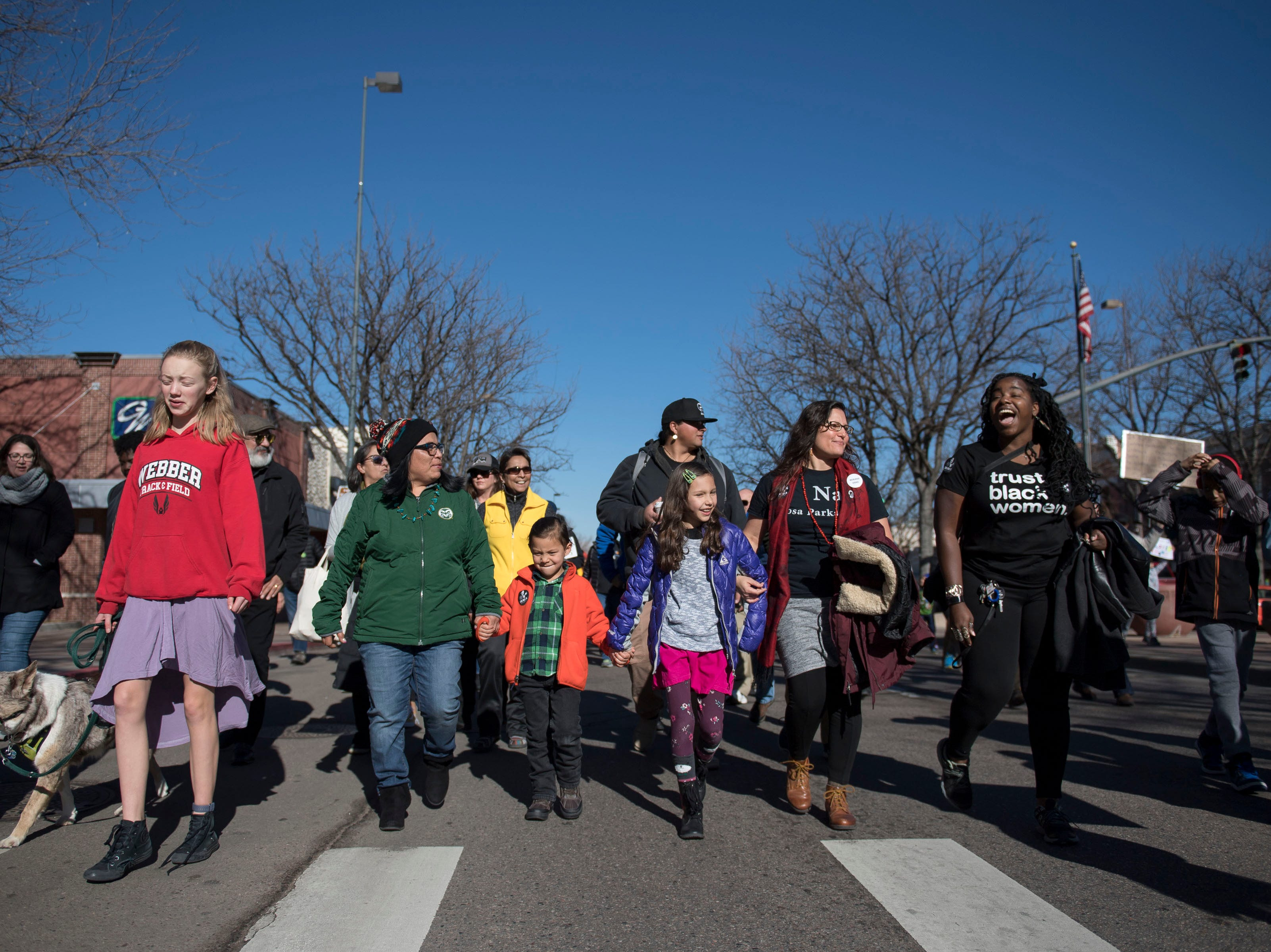 March participants head down South College Avenue during the Dr. Martin Luther King, Jr. March & Celebration on Monday, Jan. 21, 2019, in Fort Collins, Colo.