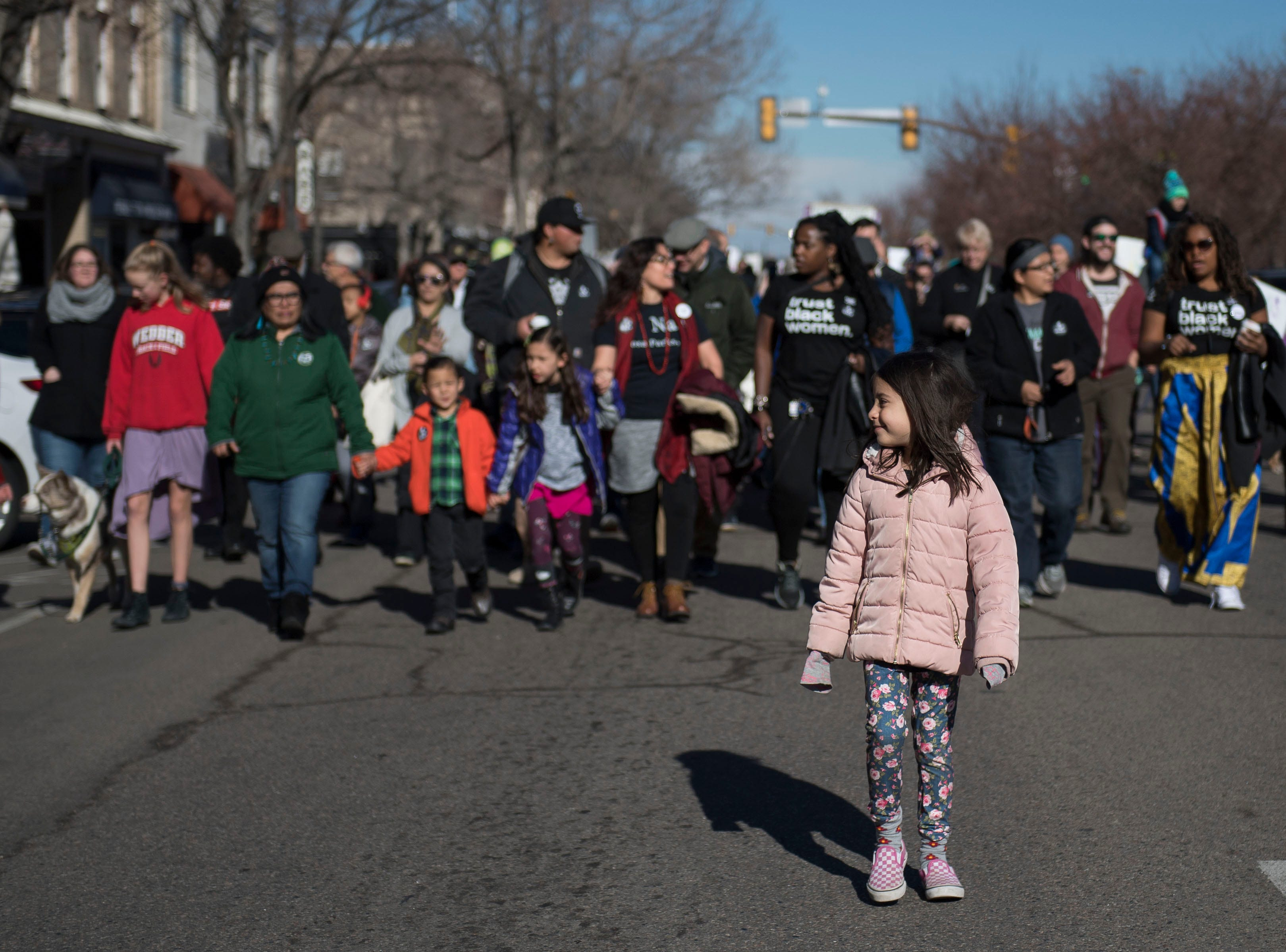 Liliana Bartecchi, 6 , walks at the front of the crowd while march participants head down South College Avenue during the Dr. Martin Luther King, Jr. March & Celebration on Monday, Jan. 21, 2019, in Fort Collins, Colo.