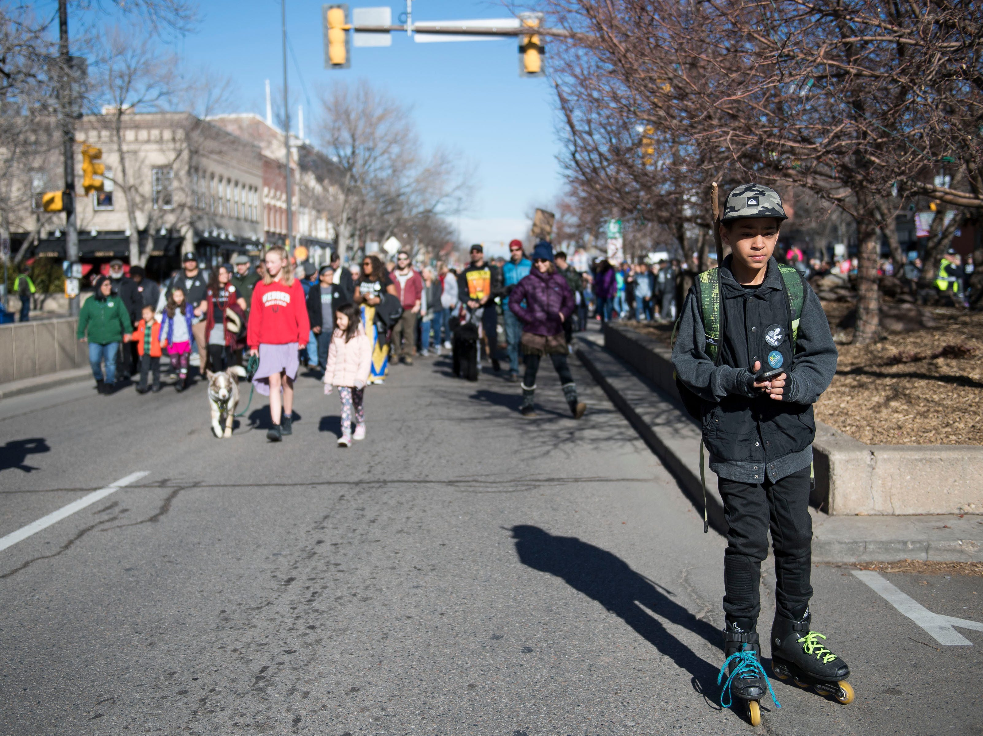 J.J. Tipton Lane, 12, rollerblades in front of the crowd while march participants head down South College Avenue during the Dr. Martin Luther King, Jr. March & Celebration on Monday, Jan. 21, 2019, in Fort Collins, Colo.