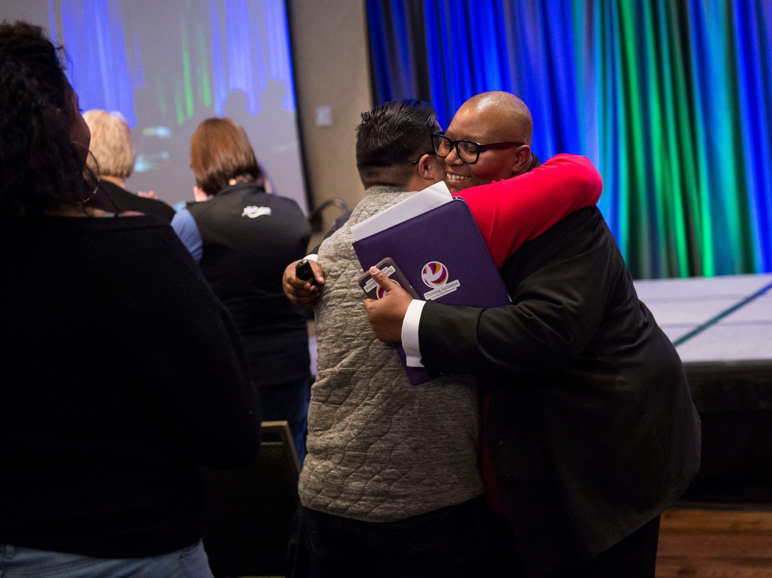 Dr. Martin Luther King, Jr. March & Celebration keynote speaker Fleurette King, right, hugs an audience member after her speech on Monday, Jan. 21, 2019, at the Lory Student Center on the Colorado State University campus in Fort Collins, Colo.