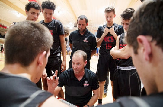 Evangelical Christian School's (ECS) basketball coach Scott Guttery leads ECS against Canterbury on Friday at ECS in Fort Myers. ECS beat Canterbury 63-47.
