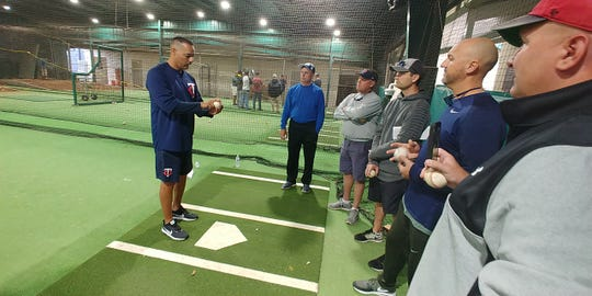 Minnesota Twins pitching coach Luis Ramirez works with Cal Ripken coaches during a clinic in Fort Myers.