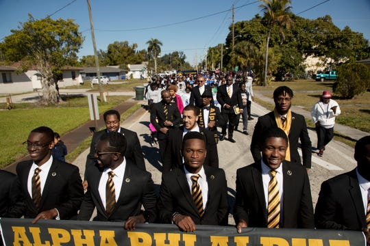 Members of the Alpha Phi Alpha Fraternity lead the annual Martin Luther King Jr. Commemorative March in Fort Myers, Fl,  Monday 1/21/2018.